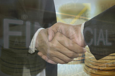finacial: Business shaking hand on finacial graph background.