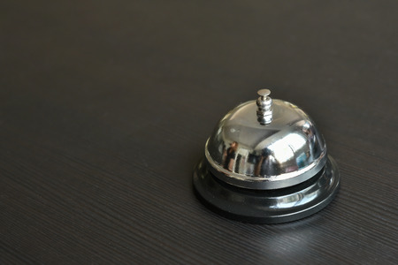 service bell: service bell on wooden table.