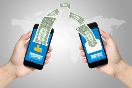 hand holding mobile using mobile banking concept. Stockfoto