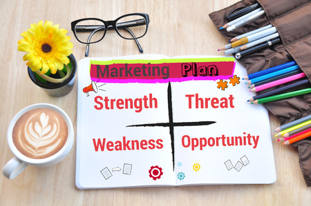 maketing: Business desktop and marketing plan Concept. Stock Photo