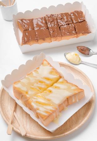 sweetened: Sweetened condensed milk, strawberry jam, peanut butter on slice bread toast isolated on white background. Stock Photo