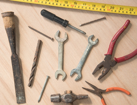 pincers: work tools hammer, wrench, screwdriver, pincers, pliers hand, screw, pliers old, spanner on a wooden table, top view with empty space Stock Photo