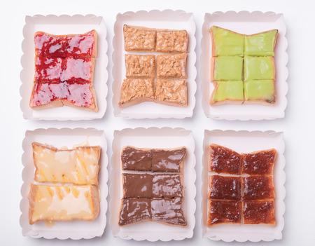 strawberry jam sandwich: Sweetened condensed milk, strawberry jam, peanut butter on slice bread toast isolated on white background. Stock Photo