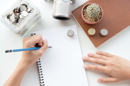 financial concept: hand writing on the paper with financial planning concept.