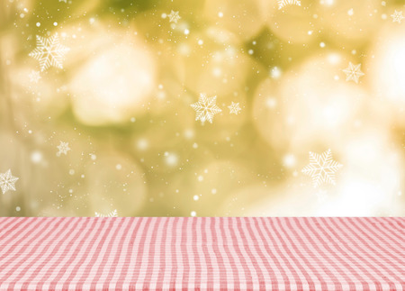 reminder: Empty red tablecloth material wooden, deck for christmas with blurred abstract background. for product display montage. Stock Photo