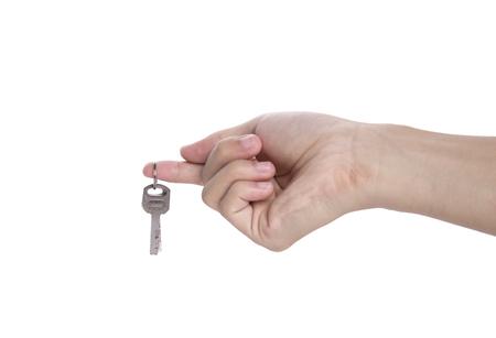 home key: hand holding home key isolated on white background. Stock Photo