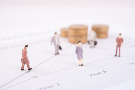 miniature people: Business concept with miniature people workers on money coin piles. business finance concept