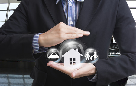 business salesman hand holding home, car, family concept home, car, family insurance. Standard-Bild