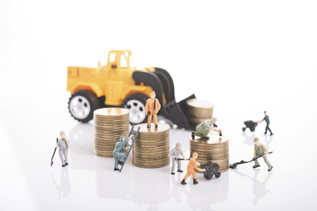 workers with pile coin money and business construction industry with concept financial planning business concept Stockfoto