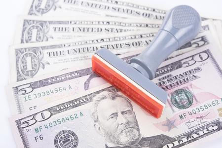stamper: Rubber stamper with dollar bills, concept success finance and banking