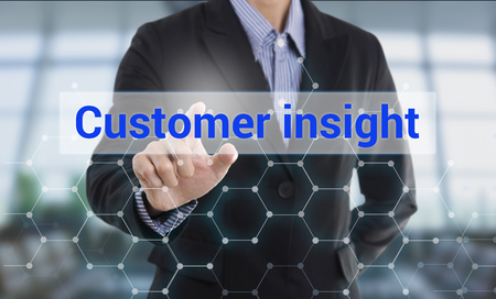 Businessman hand pressing button customer insight. sign on virtual screen. business concept.