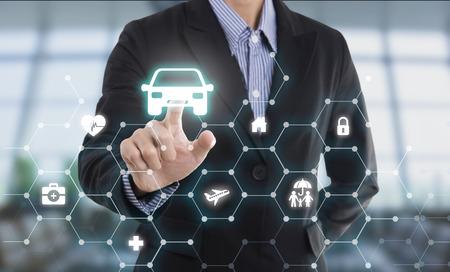 business salesman agent hand pressing button protection car concept travel insurance. Banco de Imagens - 66142853
