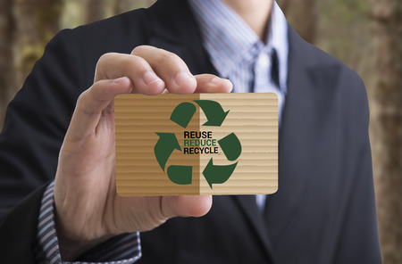 businesscard: Businessman holding businesscard message recycle, reduce, reuse.Environmental concept recycle, reduce, reuse. Stock Photo