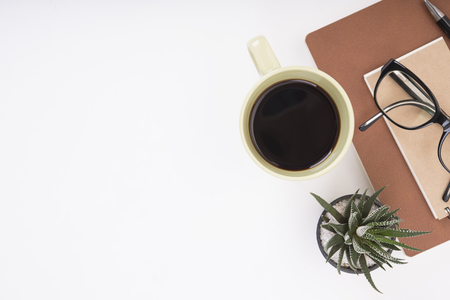 Modern Office desk with notebook, pen, paper book and coffee cup.Top View table from above with copy space for input the text. Stock fotó - 66144978