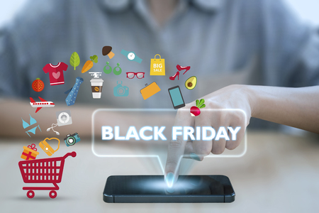Woman using smart phone pressing button black friday icon. concept shopping online.