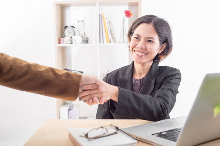 critical thinking: business people handshake and talking discussing concept meeting in workplace. Stock Photo