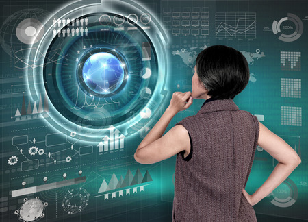 science education: Businesswomen with financial analysis graph and key performance indicators on virtual screen. Stock Photo