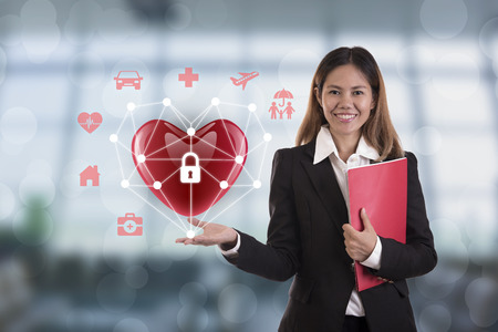business salesman agent hand holding red heart. concept accident prevention healthcare insurance. Stock Photo