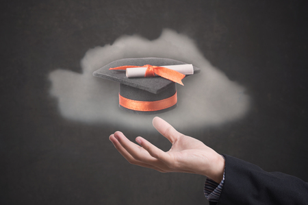 hand holding graduation hat on black background. concept education of new ideas with innovation and creativity. Stock Photo