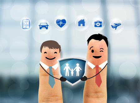 business salesman agent hand holding family protection. concept accident prevention healthcare insurance.   Standard-Bild