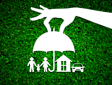 insurer: paper salesman agent hand holding family protection on green leaves background. concept accident prevention healthcare insurance.