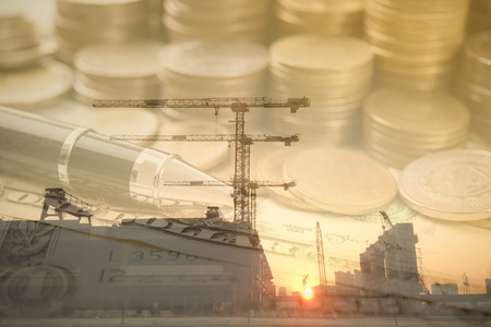 Double exposure gold coins money and construction background. for economy investment finance and banking concept. Stock fotó - 74296655