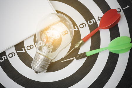gifted: lightbulb on dartboard with arrow. concept goal for new ideas with innovation and creativity. Stock Photo