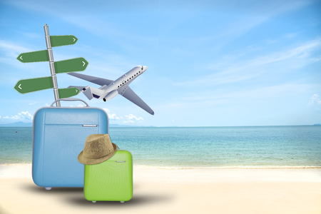 Travel transportation plane concept suitcase and tourist stuff over tropical beach background. Stock Photo