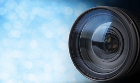 closeup camera lens with blurred bokeh light background.