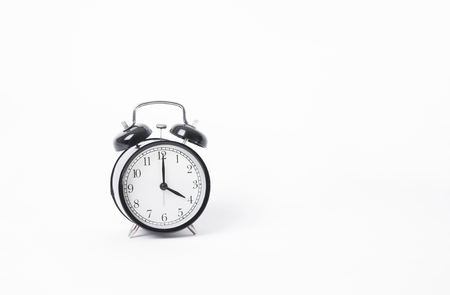reflect: black alarm clock isolated on white table background and reflect. Stock Photo