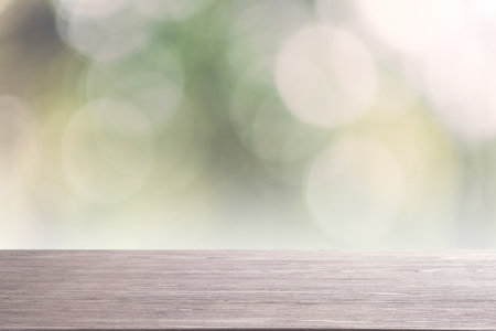 top empty wood table on blurred abstract nature background. can be used for display or montage your product. Stock Photo