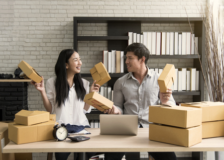 business digital online is small business a new start up in the present for online shop. By woman and man owner have a warehouse used to send to customer. SME entrepreneur concept Archivio Fotografico