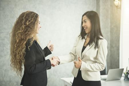 Businesswoman making handshake agreement in office. concept cooperation.  Stockfoto
