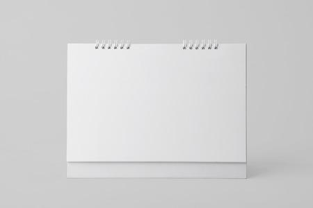Calendrier en spirale de papier vierge pour la publicité de modèle de maquette et l'arrière-plan de la marque. Banque d'images