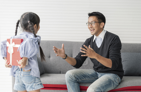 Asian daughter give present for father. concept surprise for father's day. Stockfoto