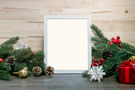 Christmas holiday greeting frame design mockup with decoration on wood table. Banco de Imagens