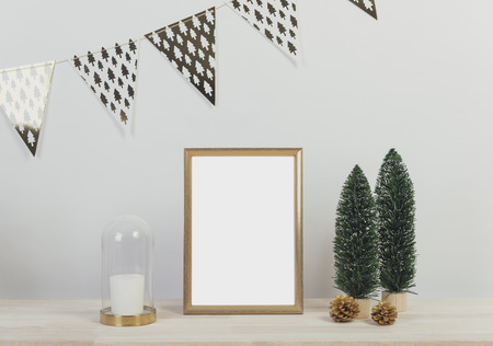 Christmas holiday greeting frame design mockup with decoration on wood table. Stock Photo
