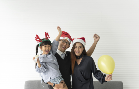 Family Asian mother and father with daughter happy christmas together in livingroom at home.