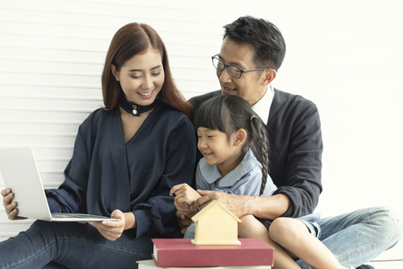 Family Asian mother and father with daughter happy together in livingroom at home. 스톡 콘텐츠