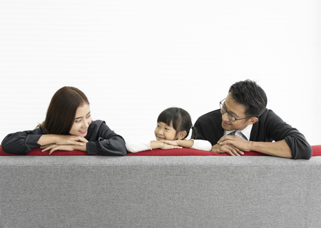 Family Asian mother and father with daughter happy togetheron sofa in livingroom at home. 스톡 콘텐츠