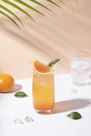 Cold and refreshing orange punch cocktail with orange slice on color background. summer drink. Reklamní fotografie