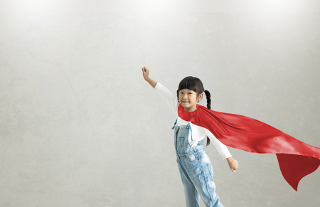 Asian child acting to be superhero.Imanigination and success concept.Play creative thinking in kid.