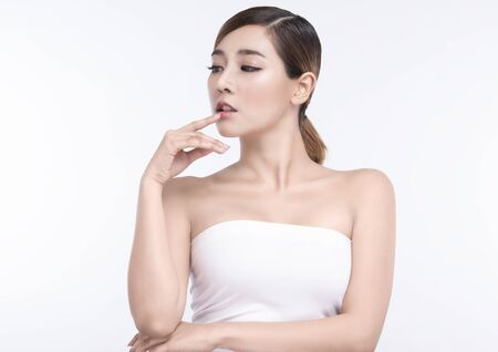 Beauty Young asian woman with perfect facial skin and lips. Gestures for advertisement treatment spa and cosmetology. Imagens