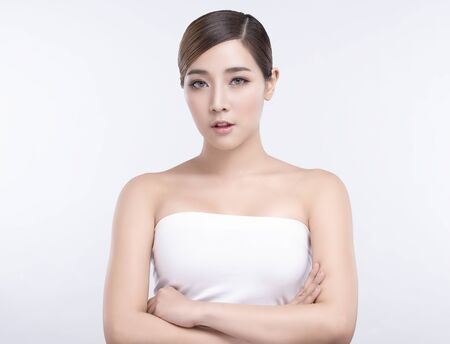 Beauty Young asian woman with perfect facial skin. Gestures for advertisement treatment spa and cosmetology. Imagens