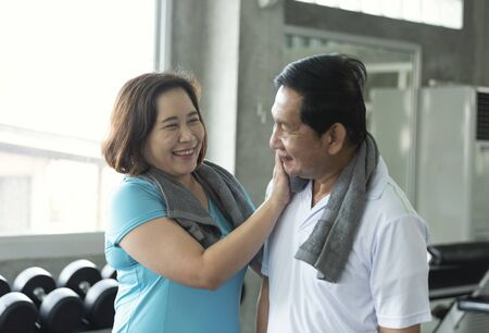 Asian senior adult couple care together after exercise fitness strength.