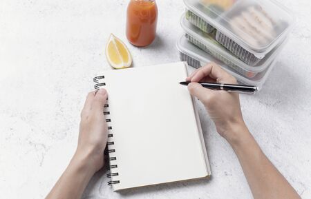 hand writing notebook for list menu healthy lunch box. order food concept.