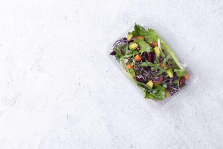 fresh healthy diet lunch box with vegetable salad on table background. free text space for diet menu.