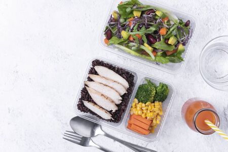 Fresh healthy diet lunch box with vegetable salad on table background with free text space for diet menu.