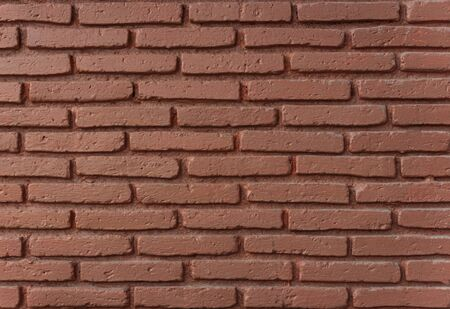 Red brick wall detail for texture background.