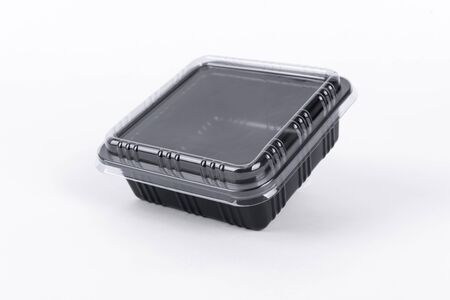 Black Plastic food box package isolated on white background. Фото со стока